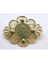 Brooch with coin