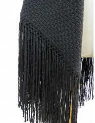 Blanket or black shawl with fringes