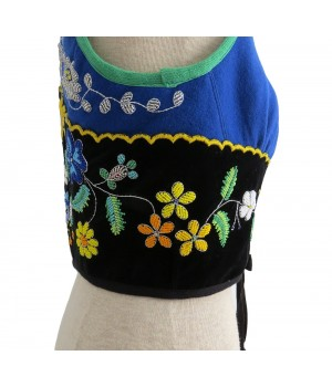 Blue vest embroidered with beads